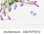 Violet Flowers On White Wooden...