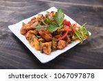 crispy chilli paneer | Shutterstock . vector #1067097878