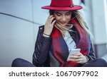 photo of a woman using smart... | Shutterstock . vector #1067097902