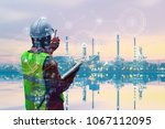 double exposure of engineer... | Shutterstock . vector #1067112095