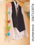 the bridegroom's jacket on the... | Shutterstock . vector #1067113076