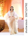"""Small photo of Bangkok, Thailand - April 8, 2018 ; Model walks in Fashion Show of Wedding Dress in """"Myriad new collection at Landmark Hotel"""
