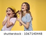 girls  cheerful  studio        ... | Shutterstock . vector #1067140448