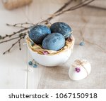 blue  and white easter eggs.... | Shutterstock . vector #1067150918