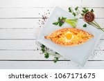 khachapuri with egg and cheese. ...   Shutterstock . vector #1067171675