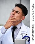 Small photo of Male Doctor Thinking
