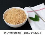 Small photo of Thai mama noodles instant food in white bowl and chopsticks. on black background.