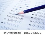 answer sheets with pencil... | Shutterstock . vector #1067243372