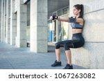 young sportswoman doing wall... | Shutterstock . vector #1067263082