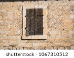 stone building with old wooden... | Shutterstock . vector #1067310512