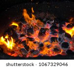 burning firewood in the... | Shutterstock . vector #1067329046