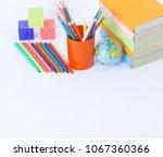 textbooks and school supplies... | Shutterstock . vector #1067360366