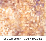 golden abstract bokeh shiny... | Shutterstock . vector #1067392562