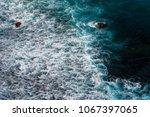 wave splashing rock near the... | Shutterstock . vector #1067397065
