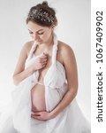 photo pregnant girl in a silver ... | Shutterstock . vector #1067409902