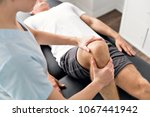 patient at the physiotherapy... | Shutterstock . vector #1067441942