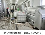 winemakers in wine production... | Shutterstock . vector #1067469248
