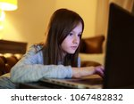 girl use of the laptop compute | Shutterstock . vector #1067482832