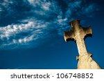Cross Against Cloudy Blue Sky