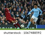 Small photo of MANCHESTER, ENGLAND - APRIL 10: Mohamed Salah and Leroy Sane during the Champions League quarter final match between Manchester City and Liverpool at the Etihad Stadium on April 10, 2018