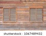 thai double wooden  shutter... | Shutterstock . vector #1067489432