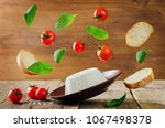 ricotta cheese with flying... | Shutterstock . vector #1067498378