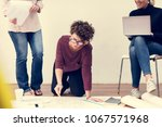 woman working on a document    Shutterstock . vector #1067571968