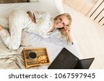 positive young woman checking... | Shutterstock . vector #1067597945