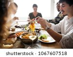 friends gathering having... | Shutterstock . vector #1067607518