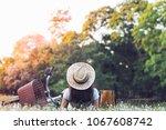 sitting woman near her bike in... | Shutterstock . vector #1067608742