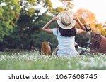 sitting woman near her bike in... | Shutterstock . vector #1067608745