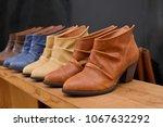 shoe shop   leather boots... | Shutterstock . vector #1067632292
