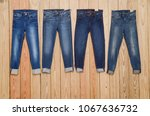 four blue jeans on wooden... | Shutterstock . vector #1067636732