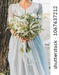 bride wearing light blue... | Shutterstock . vector #1067637212