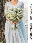 bride wearing light blue...   Shutterstock . vector #1067637212