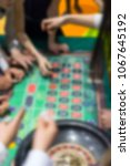 Small photo of Casino roulette, betting on the result, chance to win money, fortune, blur