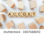 Small photo of ACCOST word on wooden cubes