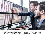 Businessmen Trading Stocks....