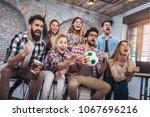 happy friends or football fans... | Shutterstock . vector #1067696216