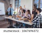 business people having on... | Shutterstock . vector #1067696372