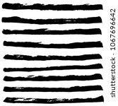 set of black ink horizontal... | Shutterstock . vector #1067696642