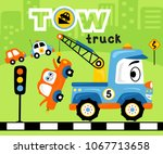 funny tow truck with wreck cars.... | Shutterstock .eps vector #1067713658