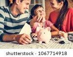 kid earning money for future | Shutterstock . vector #1067714918