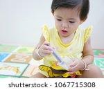 selective focus of little asian ... | Shutterstock . vector #1067715308