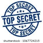 top secret blue round grunge... | Shutterstock .eps vector #1067724215