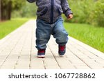 baby's first steps.the first... | Shutterstock . vector #1067728862