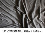 crumpled gray fabric texture... | Shutterstock . vector #1067741582