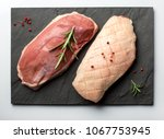 raw duck breasts  magret on a... | Shutterstock . vector #1067753945