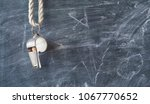 whistle of a soccer coach or... | Shutterstock . vector #1067770652