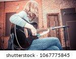 girl playing guitar in... | Shutterstock . vector #1067775845